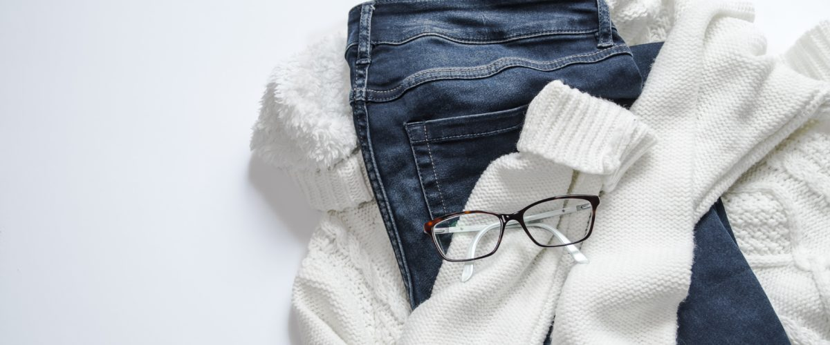 Black Framed Eyeglasses On White Jacket And Blue Denim 934070